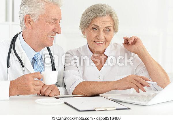 Senior doctor with a elderly patient - csp58316480