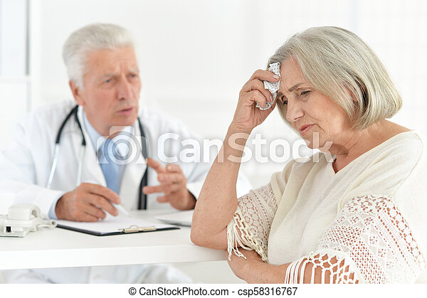 Senior doctor with a elderly patient - csp58316767