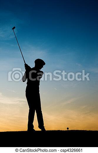 Senior female golf player at sunset - csp4326661