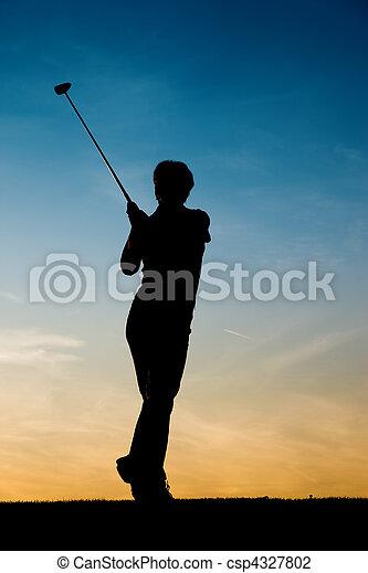 Senior female golf player at sunset - csp4327802