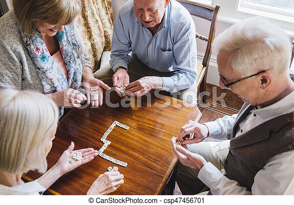 Senior Friends Playing Dominoes - csp47456701