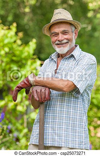 Senior gardener with a spade - csp25073271