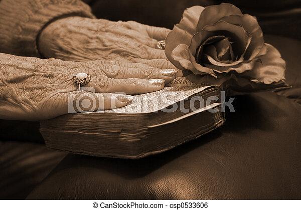 Senior hands on a bible - csp0533606