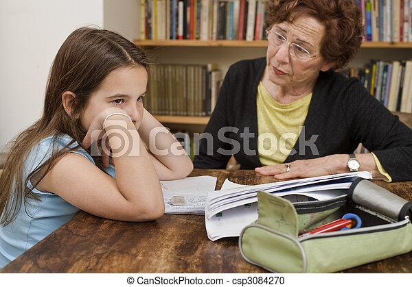 senior helping child doing homework - csp3084270