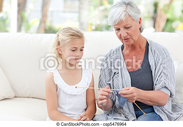 Senior knitting with her granddaughter - csp5476964
