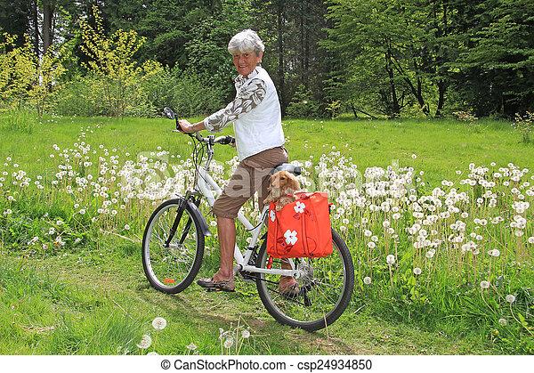Senior lady cyclist - csp24934850