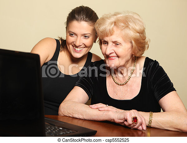 Senior lady on the computer - csp5552525