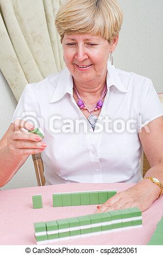 senior lady playing mahjong - csp2823061