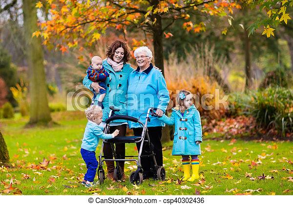 Senior lady with walker enjoying family visit - csp40302436