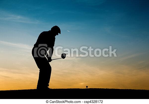 Senior male golf player at sunset - csp4328172