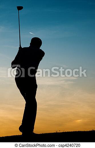 Senior male golf player at sunset - csp4240720