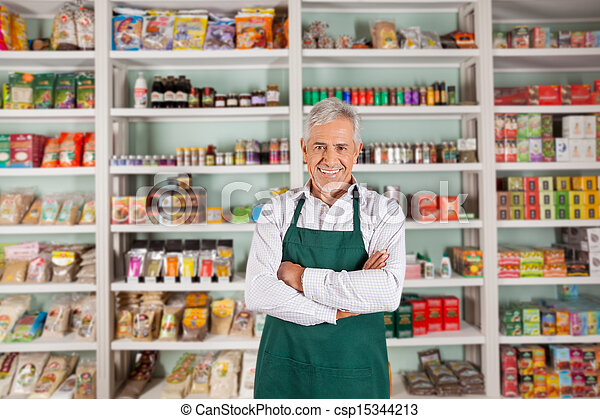 Senior Male Owner Standing In Supermarket - csp15344213