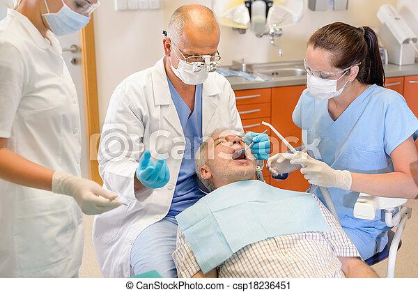 Senior man at dentist surgery have operation - csp18236451