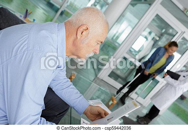 senior man at the hospital reception - csp59442036