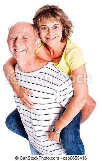 Senior man giving woman piggyback ride - csp6653416