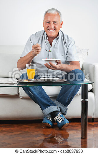 Senior Man Having Breakfast - csp8037930