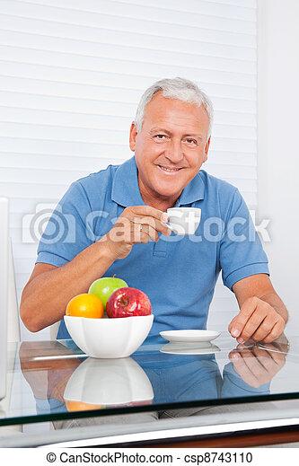Senior Man Having Cup of Tea - csp8743110