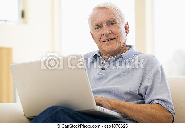 senior, man, laptop, computer, at home, sofa, browsing, surfing, interne - csp1878625