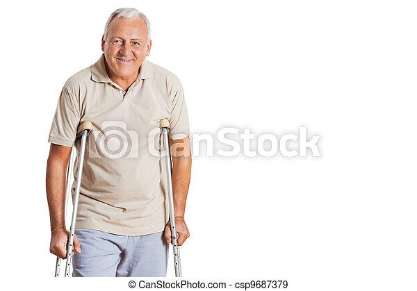Senior Man On Crutches - csp9687379
