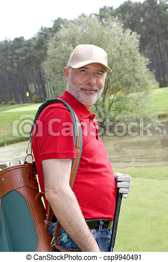 Senior man on golf course - csp9940491