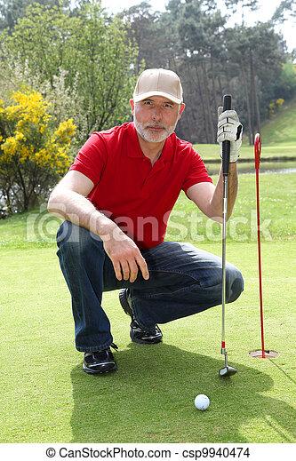 Senior man on golf course - csp9940474