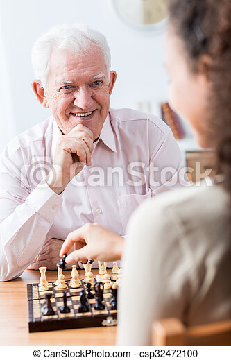Senior man playing chess - csp32472100