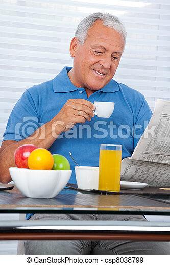 Senior Man Reading Newspaper - csp8038799
