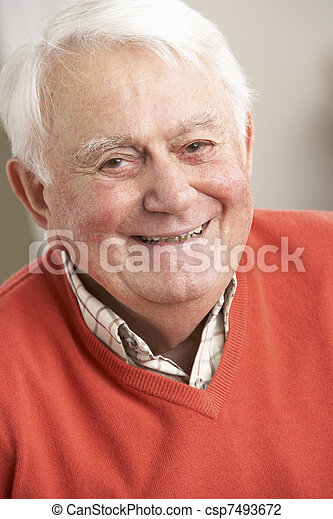 Senior Man Relaxing In Chair At Home - csp7493672