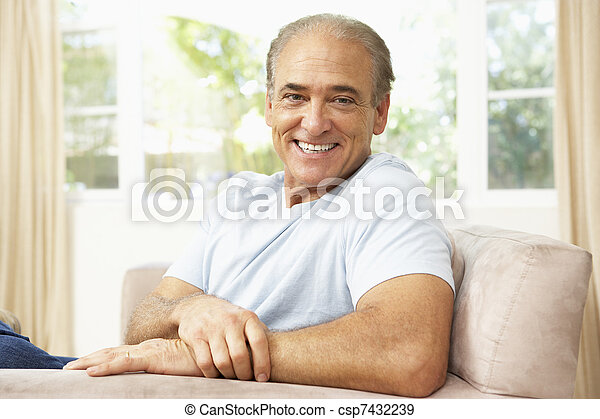 Senior Man Relaxing In Chair At Home - csp7432239