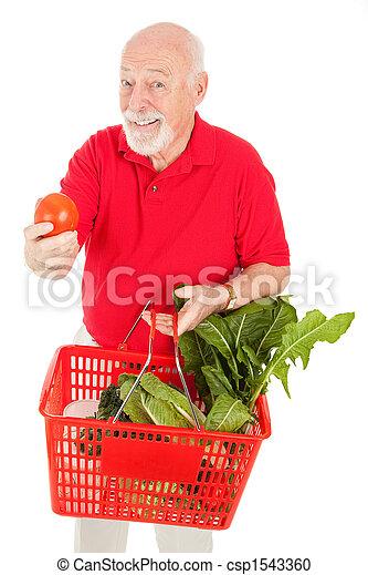 Senior Man Shops for Produce - csp1543360