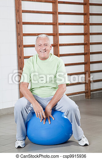 Senior Man Sits on a Fitball - csp9915936