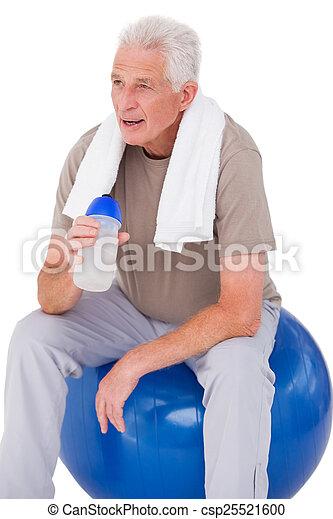 Senior man taking a break from exercise - csp25521600