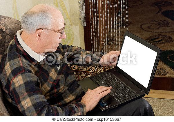 Senior man using a laptop computer - csp16153667