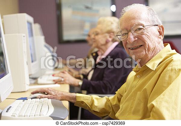 Senior man using computer - csp7429369
