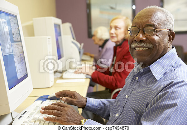 Senior man using computer - csp7434870
