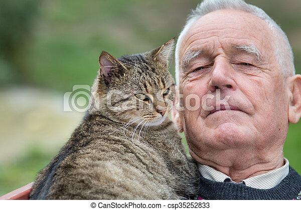 Senior man with cat - csp35252833