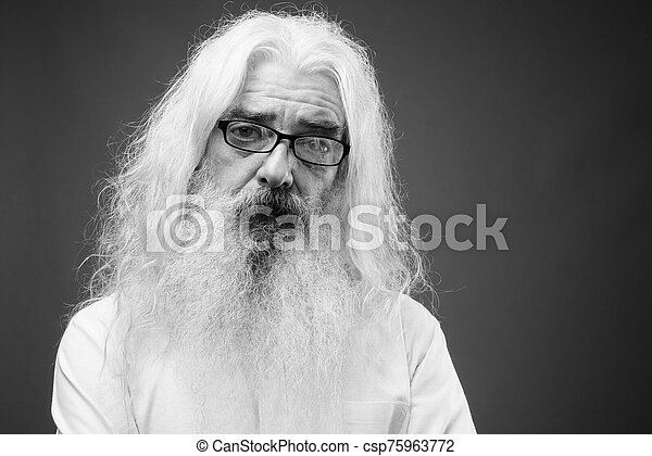 Senior man with long hair and beard in black and white - csp75963772