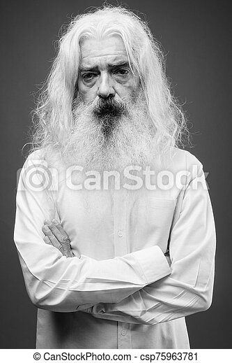 Senior man with long hair and beard in black and white - csp75963781