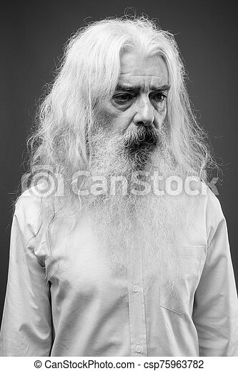 Senior man with long hair and beard in black and white - csp75963782