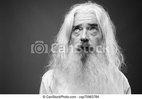 Senior man with long hair and beard in black and white - csp75963784
