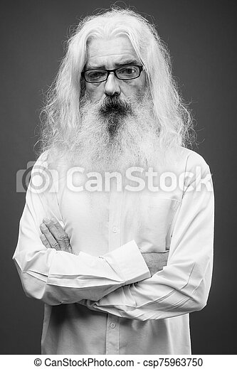 Senior man with long hair and beard in black and white - csp75963750