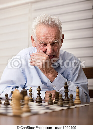 Senior men playing chess - csp41029499