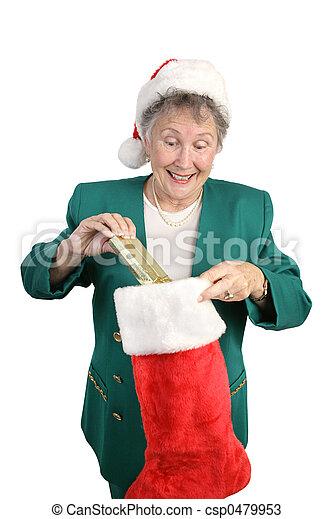 Senior Opens Christmas Stocking - csp0479953