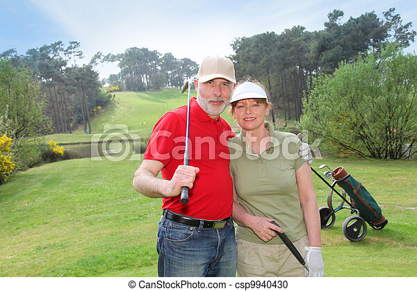 Senior people on golf course - csp9940430