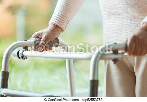 Senior person using walking frame - csp52553783