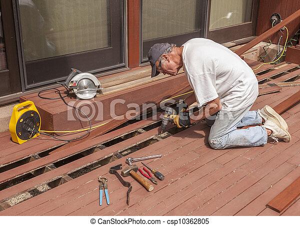 Senior repairing deck - csp10362805