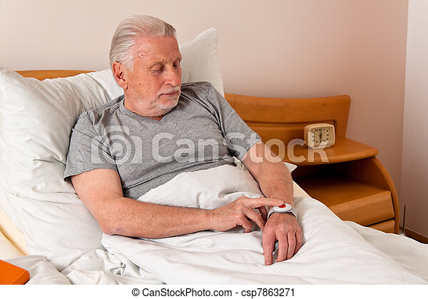 senior rufhilfe with emergency phone in bed - csp7863271