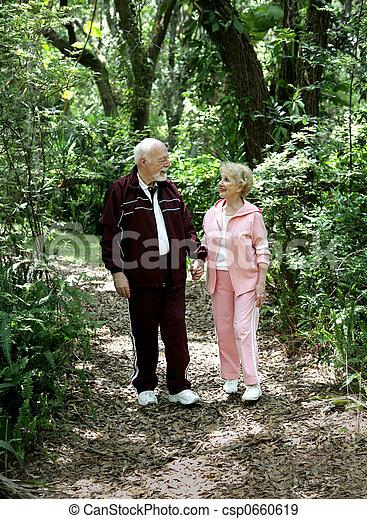 Senior Stroll in Park - csp0660619