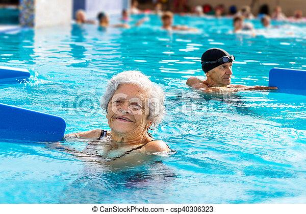 Senior woman at aqua gym session. - csp40306323