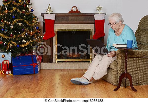 senior woman christmas shopping  - csp16256488